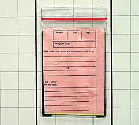 clear sealtite card holder with magnetic backing on a board